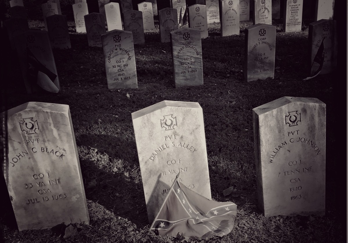 A Confederate flag decorates the tombstone of a Confederate soldier killed in the Civil War,