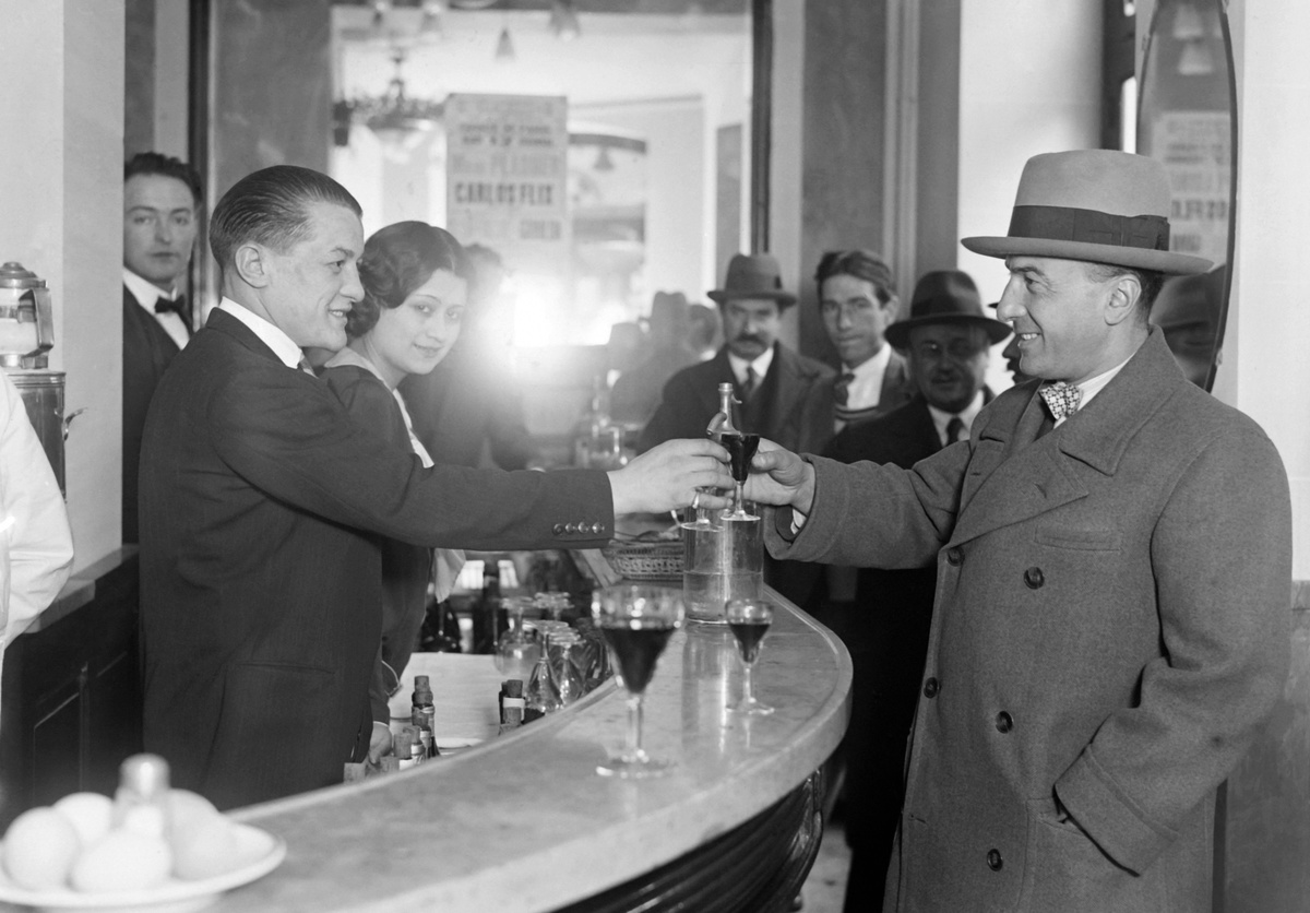 clinking with a customer, in December 1929 in Paris, France women bar rights could not buy their own drinks 1920s