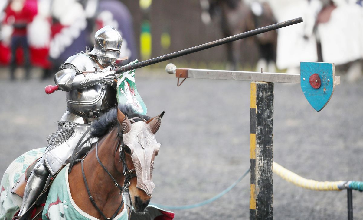 Easter Tournament at the Royal Armouries A man dressed as a knight takes part in a jousting competition female knight