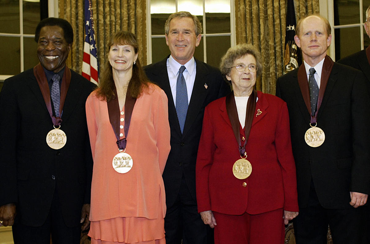 Cleary receiving an award alongside Ron Howard and George W. Bush