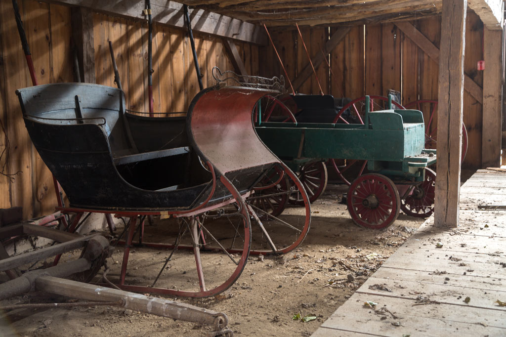 sleigh and tractor in the barn