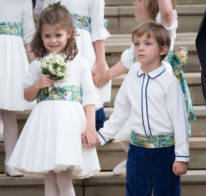 Bridesmaid Theodora Williams and pageboy Louis de Givenchy attend the wedding of Princess Eugenie of York and Jack Brooksbank at St George's Chapel in Windsor Castle on October 12, 2018 in Windsor, England.