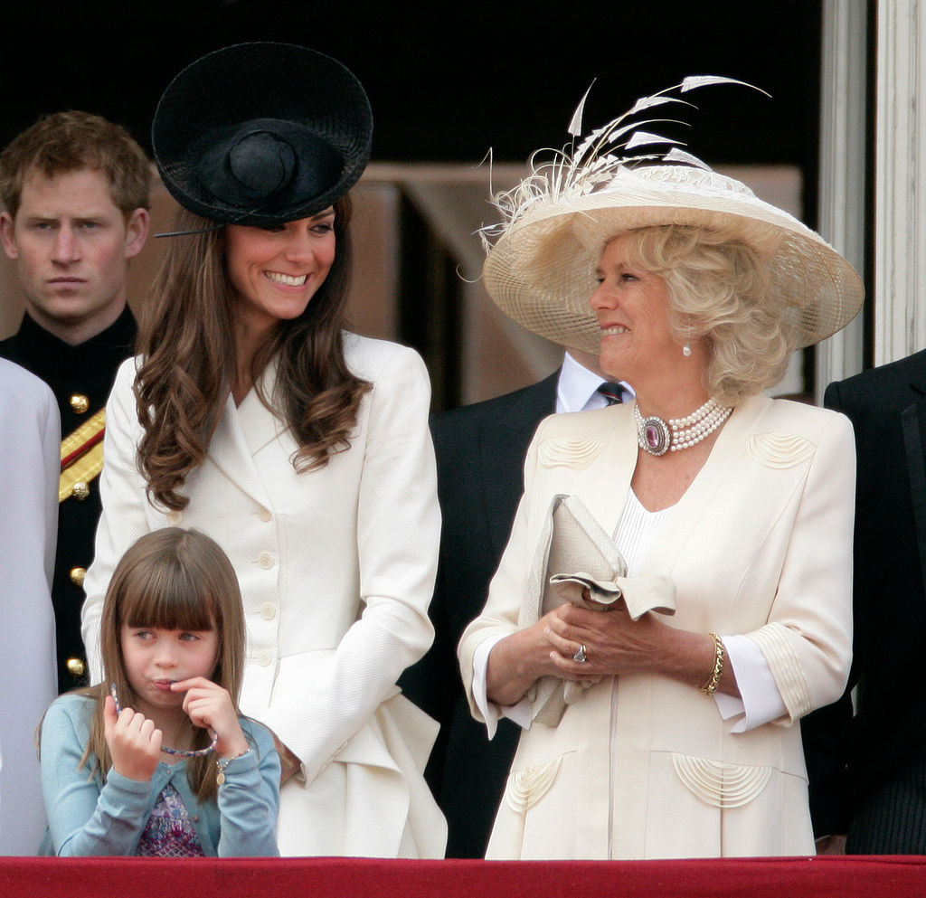 Catherine, Duchess of Cambridge, Camilla, Duchess of Cornwall and Eloise Taylor stand on the balcony of Buckingham Palace after the Trooping the Colour Parade on June 11, 2011 in London, England