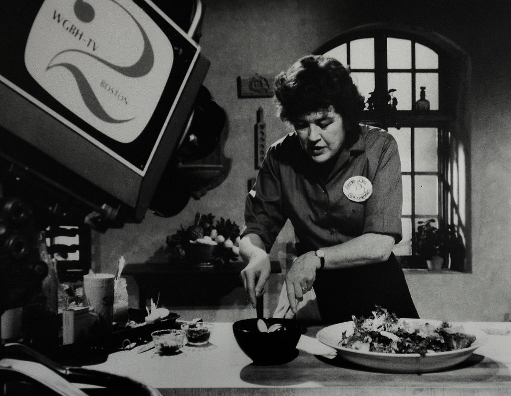On display is a vintage photo of Julia Child taping a TV show in her kitchen