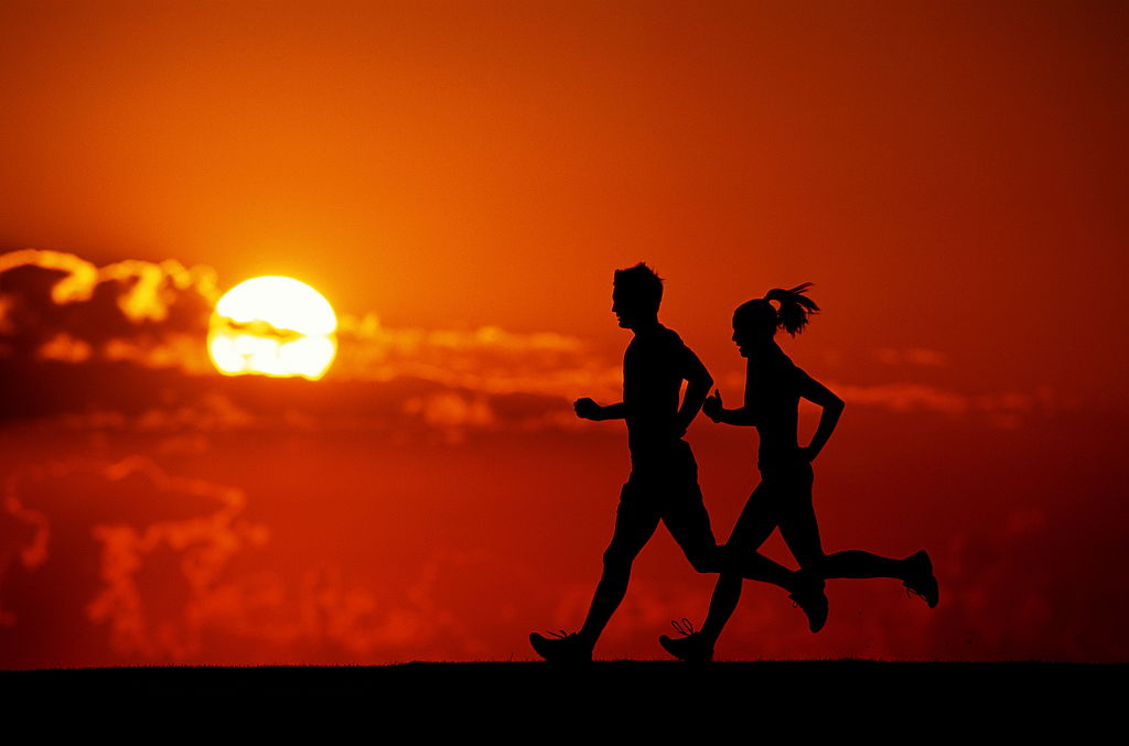 Runners, silhouette at sunset