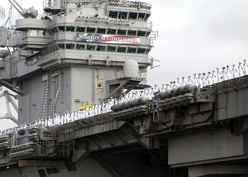 Sailors aboard USS Abraham Lincoln man the rail as they arrive at Naval Air Station North Island