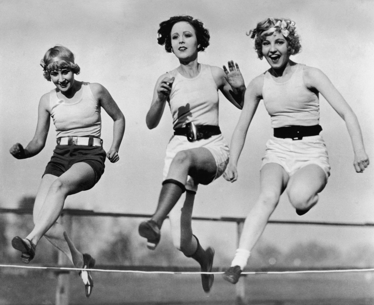 Three women in a low hurdles race at Universal City, California