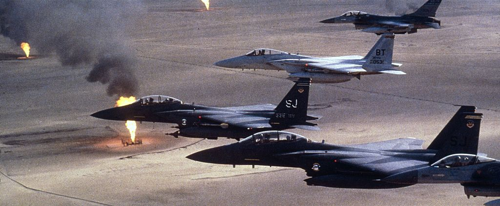 American airforce F-15 C fighters flying over a Kuwaiti oilfield