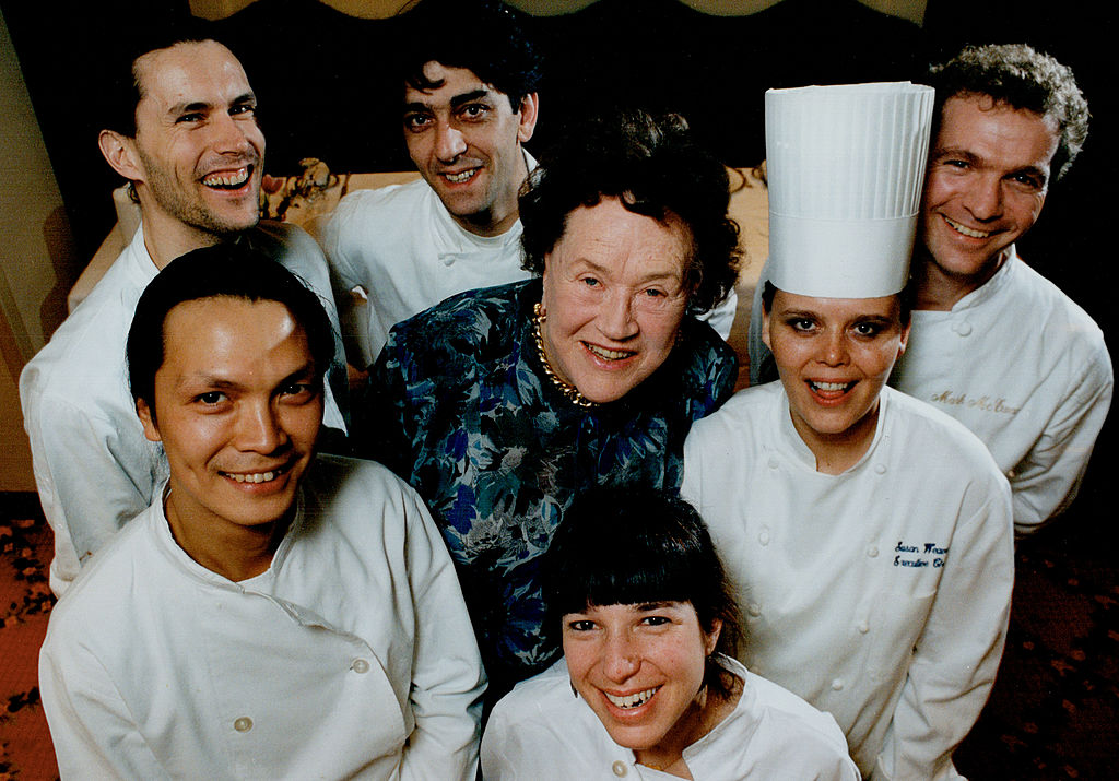 Julia Child, centre, meets, clockwise from bottom, top chefs Joanne Yolies, Susur Lee, Jamie Kennedy, Didier Leroy, Mark McEwan and Susan Weaver.