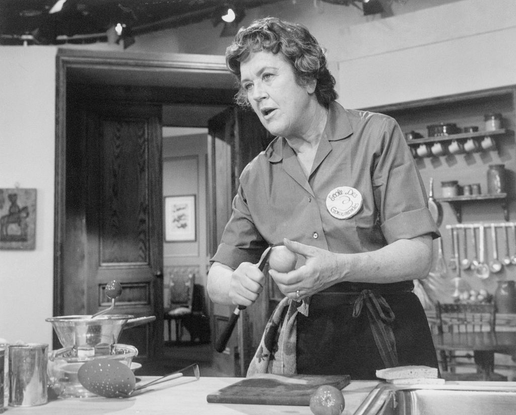Julia Child, ebullient French chef, as she prepares a dish for a TV audience