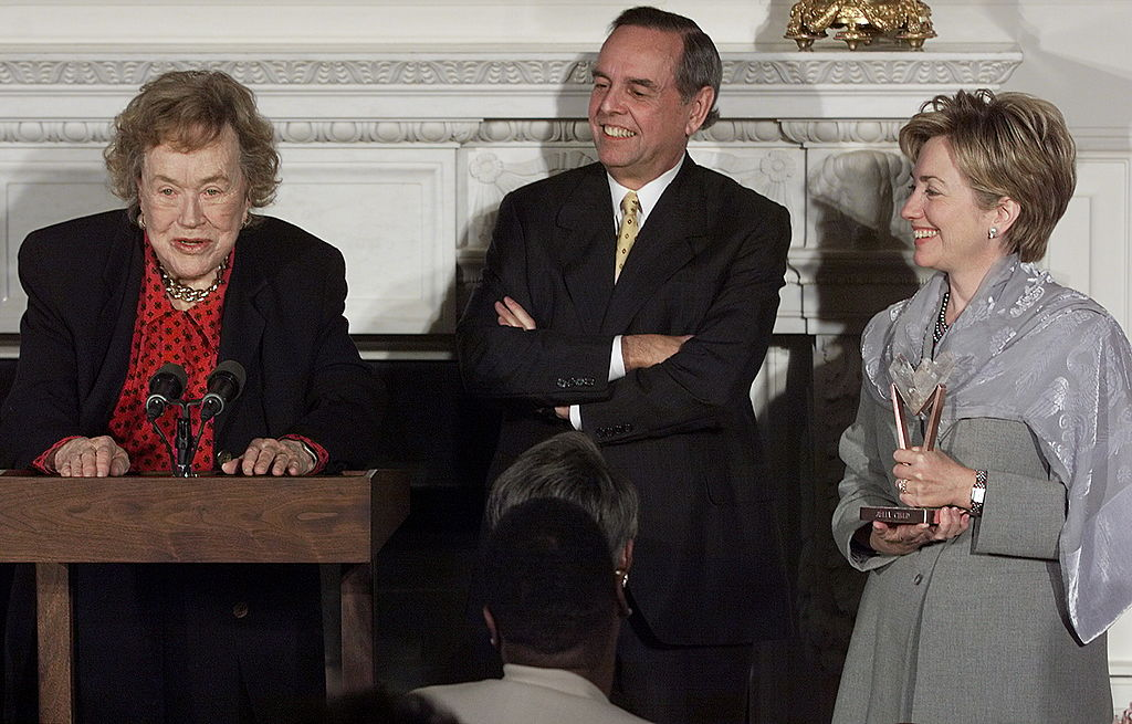 US First Lady Hillary Clinton (R) and Sara Lee Corporation Chairman and Chief Executive Officer John Bryan (C) listen 21 October, 1999 to chef and television personality Julia Child (L) at the White House in Washington, DC