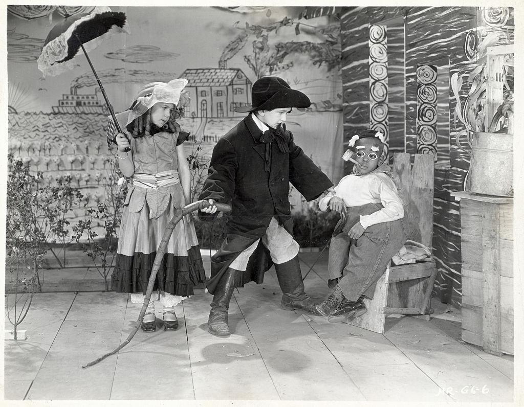 dorothy deborba with dress and umbrella on set