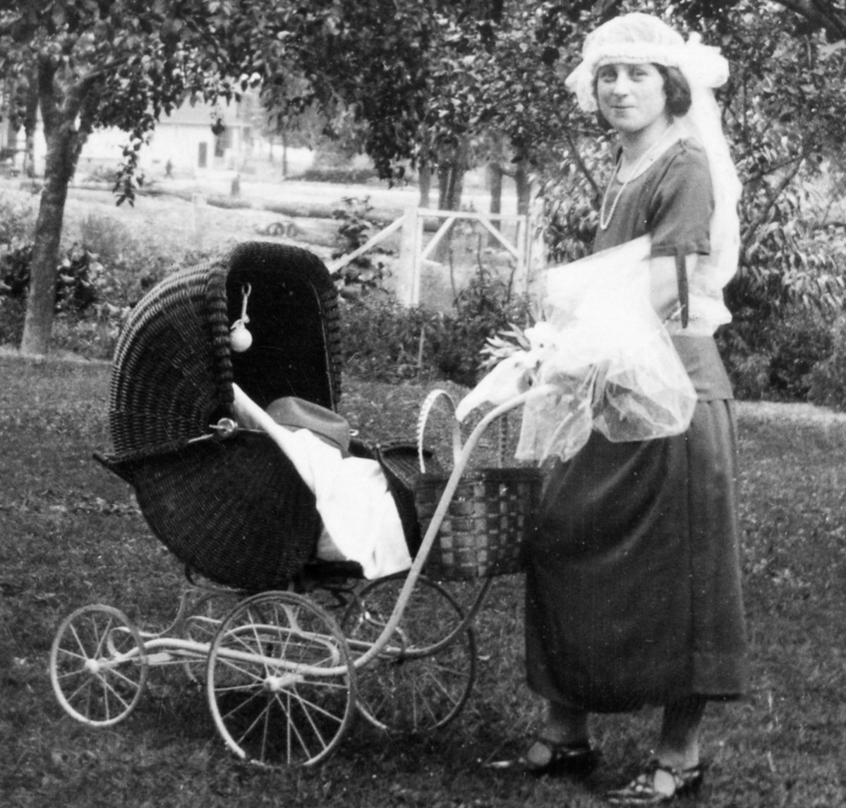 Mother to be with stroller at baby shower, ca. 1924