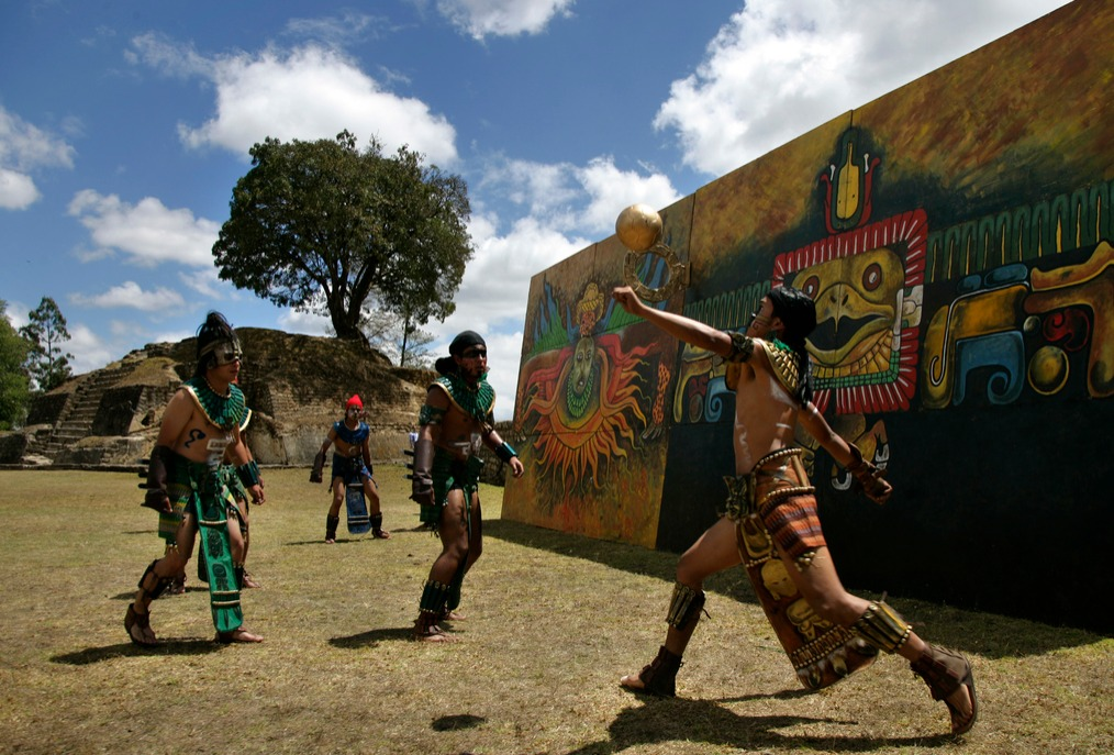 Men play an ancient Mayan ritual game called Juego de Pelota Maya, a Mayan ballgame, at the Iximche ruins.