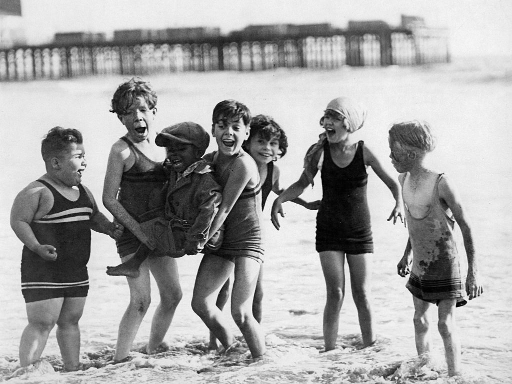 the little rascals group shot on the beach