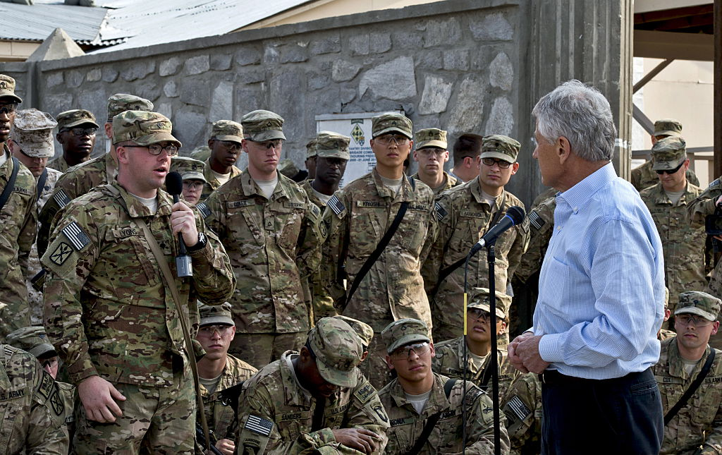 Chuck Hagel the US Defence Secretary listens to a question from a US soldier
