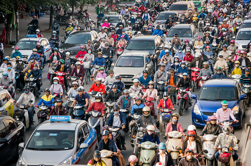 Crowds of people on motorbikes in a traffic jam