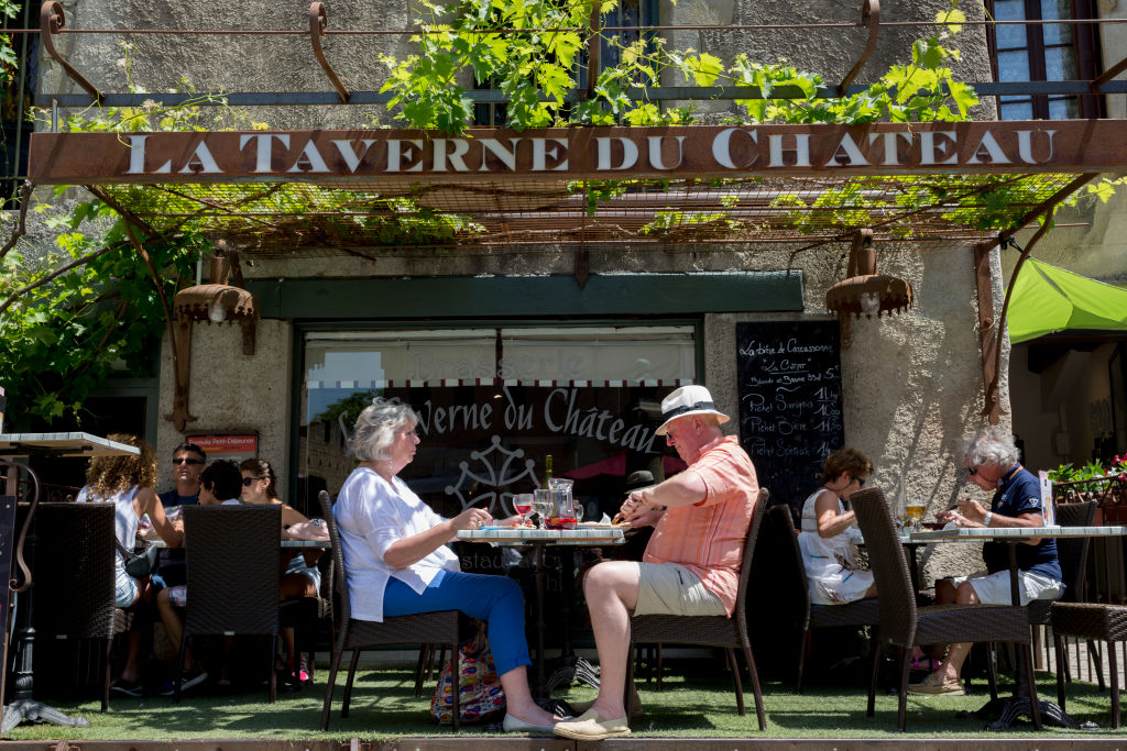 A couple eat lunch at a taverne restaurant