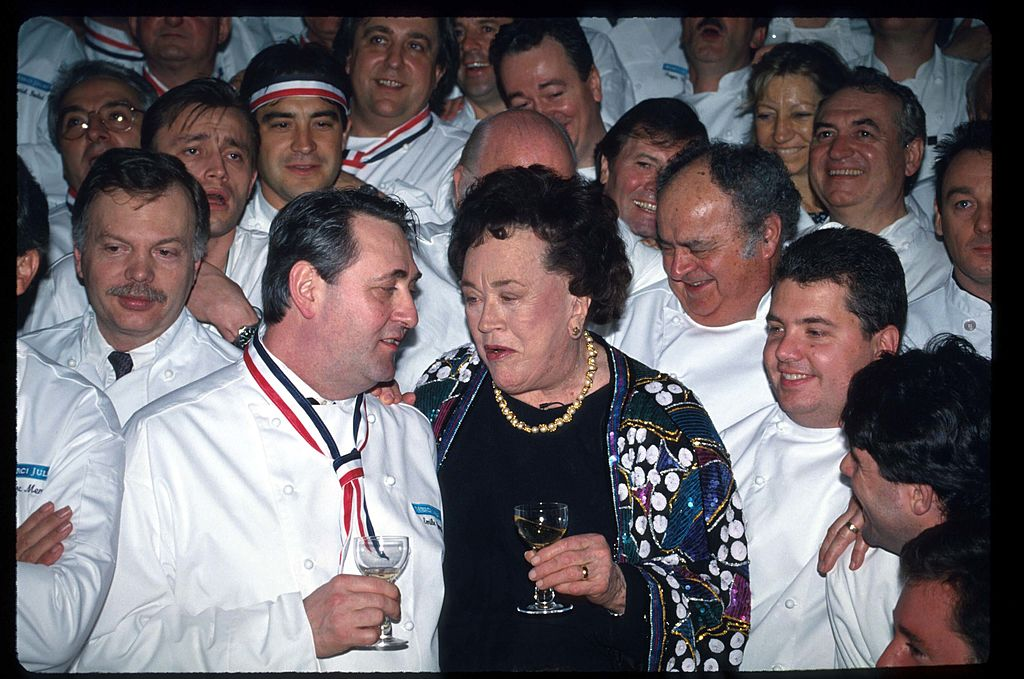 Julia Child speaks with an unidentified guest at a celebration dinner