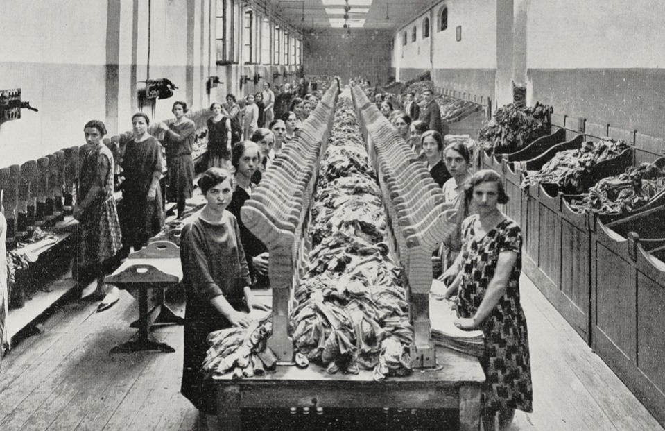 Workers at the Roberto Ferrari hosiery manufacturers plant