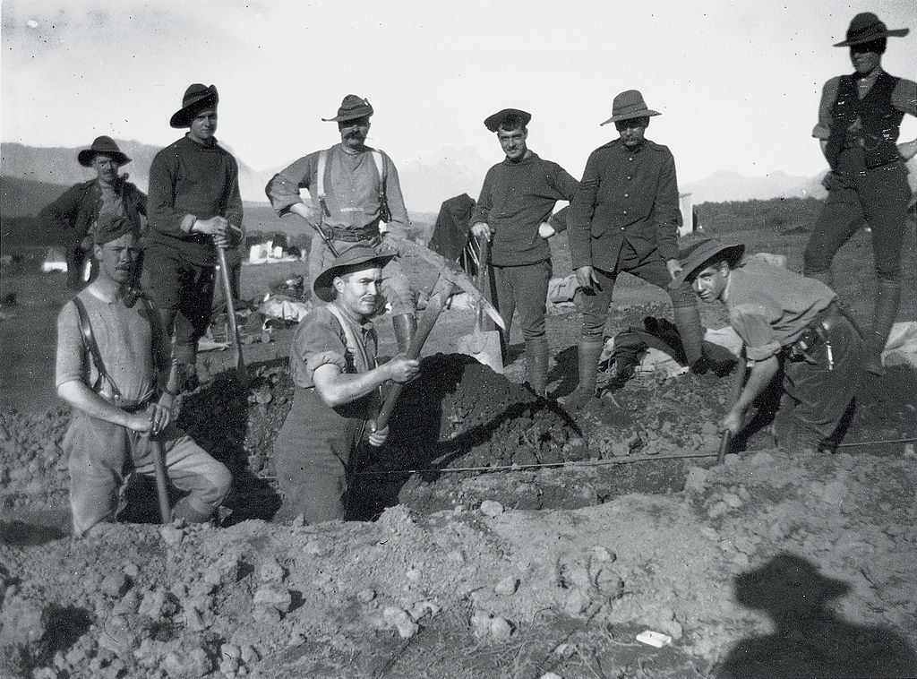 Soldiers using pickaxes to dig a trench for the Boer War