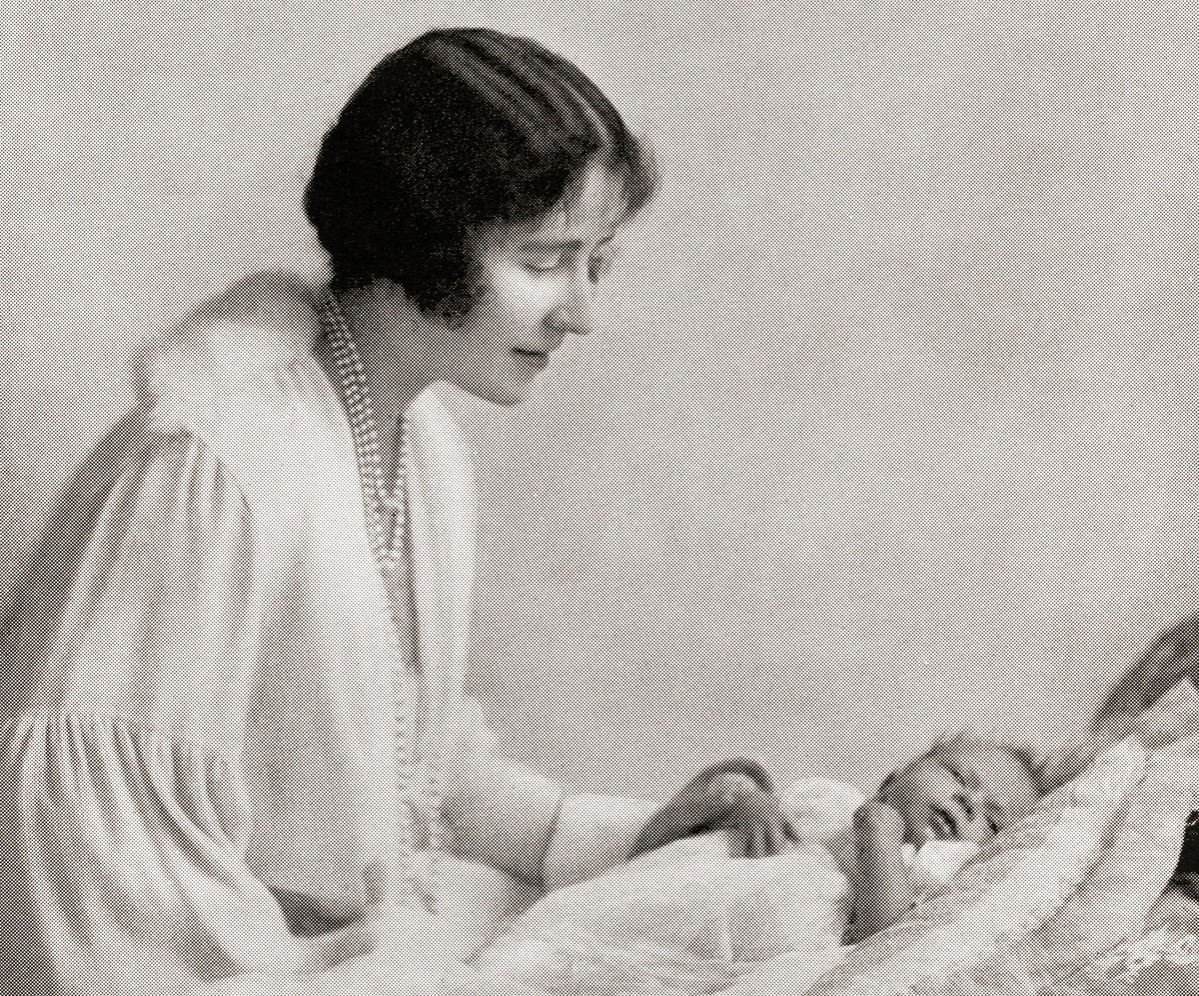 Elizabeth Angela Marguerite Bowes-Lyon, 1900 –2002. Future Queen Elizabeth, The Queen Mother. Wife of King George VI and the mother of Queen Elizabeth II. Seen here with her baby daughter princess Elizabeth in 1926.