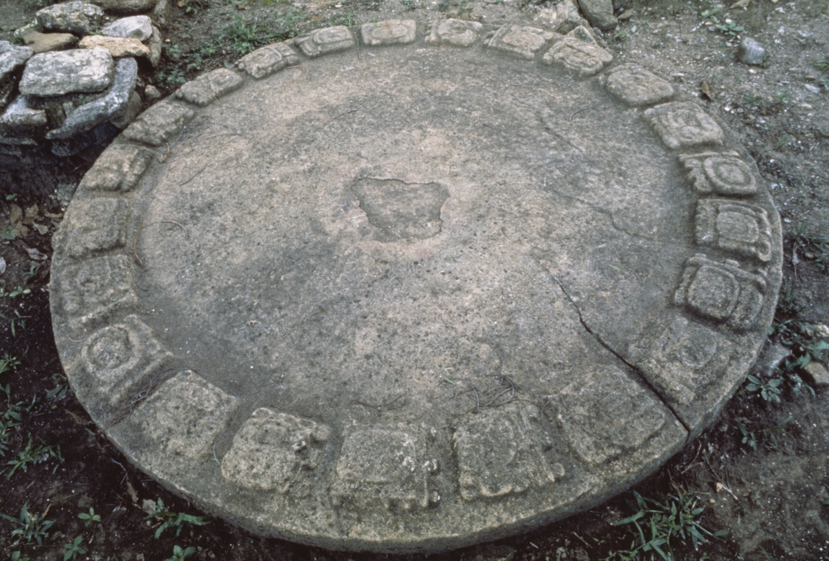 Mayan calendar disk on the ground at Tonina, a pre-Columbian archaeological site in Chiapas, Mexico.