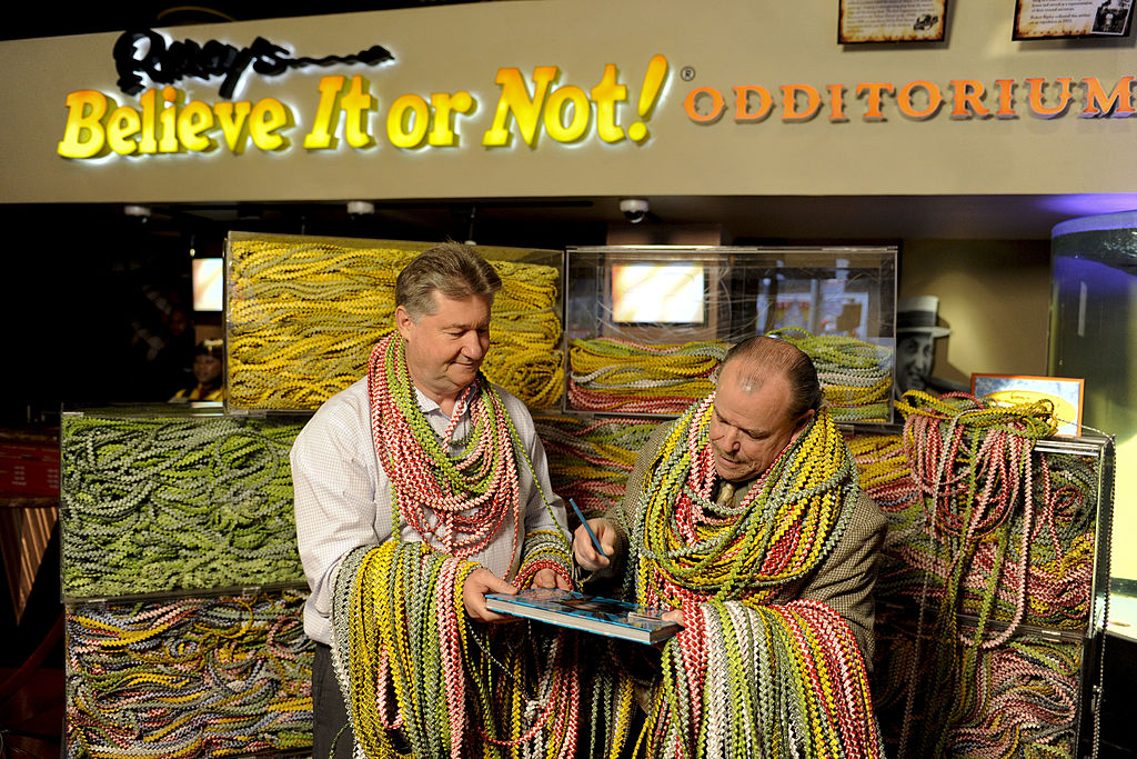 ary Duschl, creator of the largest Gum Wrapper Chain, and Jim Pattison Jr., President of Ripley Entertainment, attend the signing of link number 3 million in a 12-mile long gum wrapper chain at Ripley's Believe It or Not!
