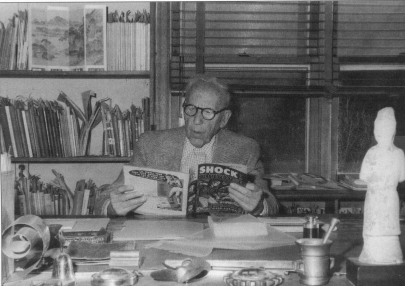 Dr. Frederic Wertham reading a comic book