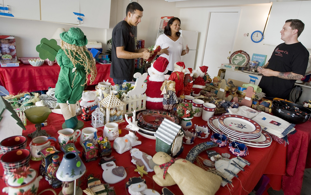 Knickknacks fill the garage in Ladera Ranch where workers prepare for an estate sale.