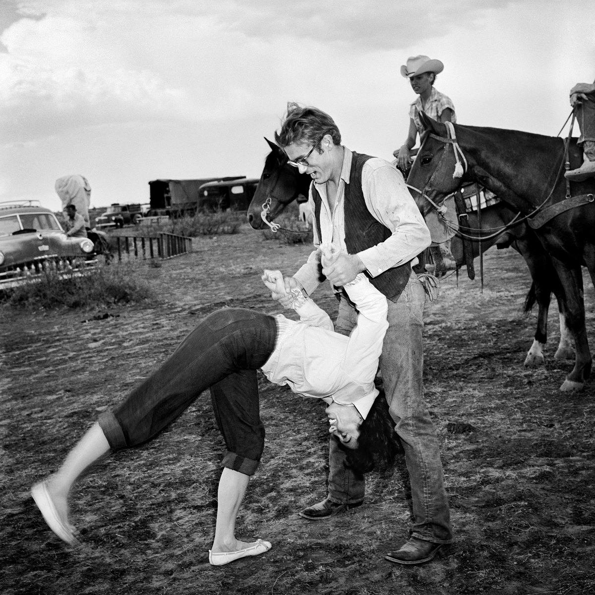 Actress Elizabeth Taylor goes head over heels as actor James Dean helps on the set of the movie 'Giant' which was released on November 24, 1956.