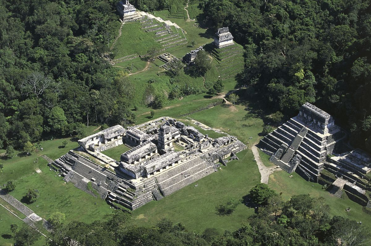 Aerial view over El Palacio and the Temple of the Inscriptions, archaeological site of Palenque in Mexico.