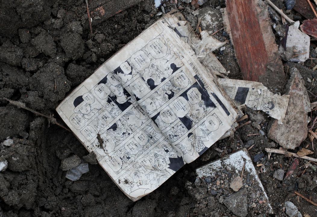 A comic book is seen amongst the rubble in Rikuzentakata, Japan.