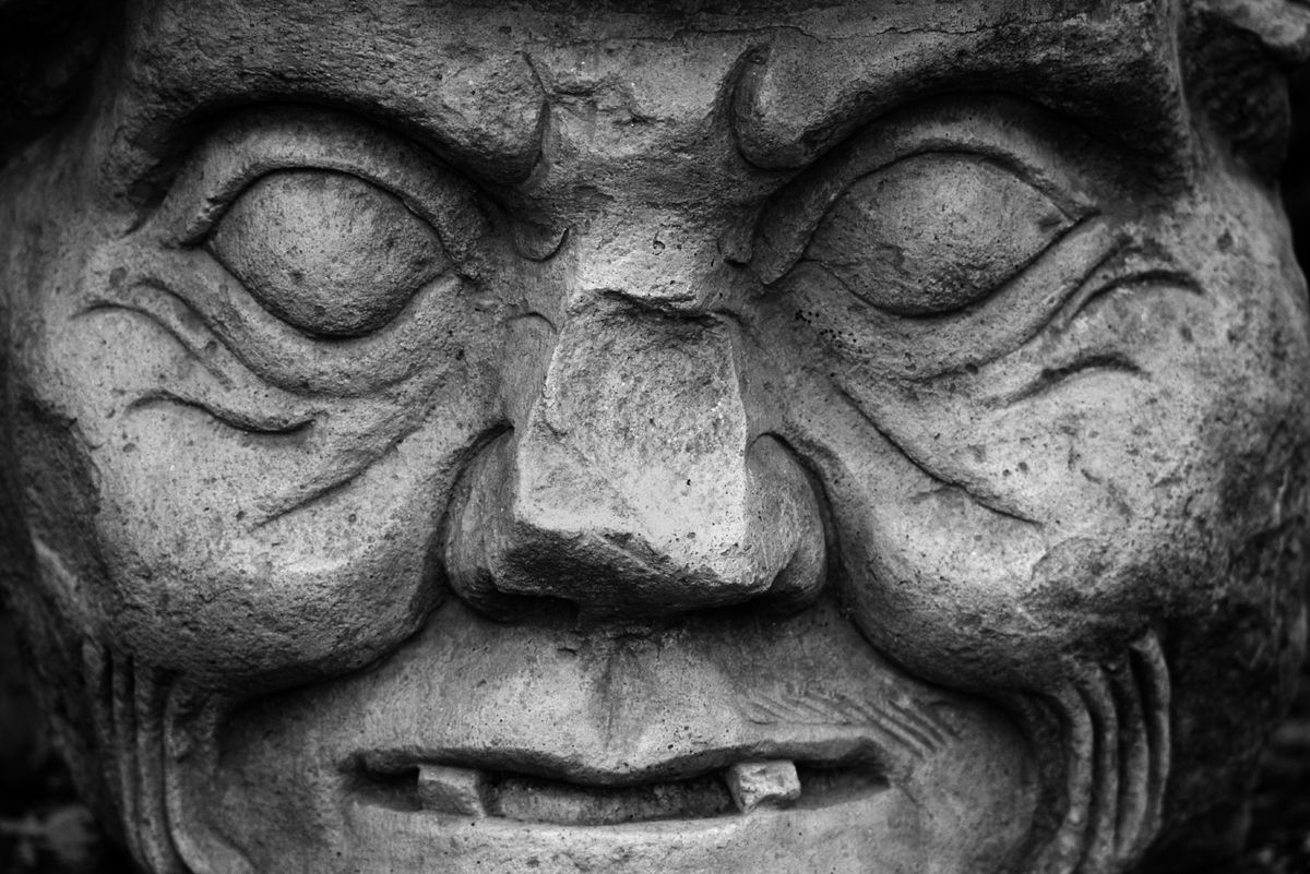 STONE SCULPTURE of MAYAN GOD of MEDECINE & SCIENCE, COPAN RUINS, HONDURAS.