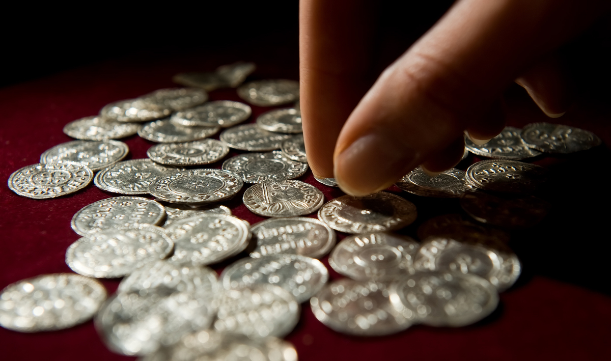 Silver coins from the Vale of York viking hoard are displayed at a press conference to unveil the newly conserved hoard at the British Museum