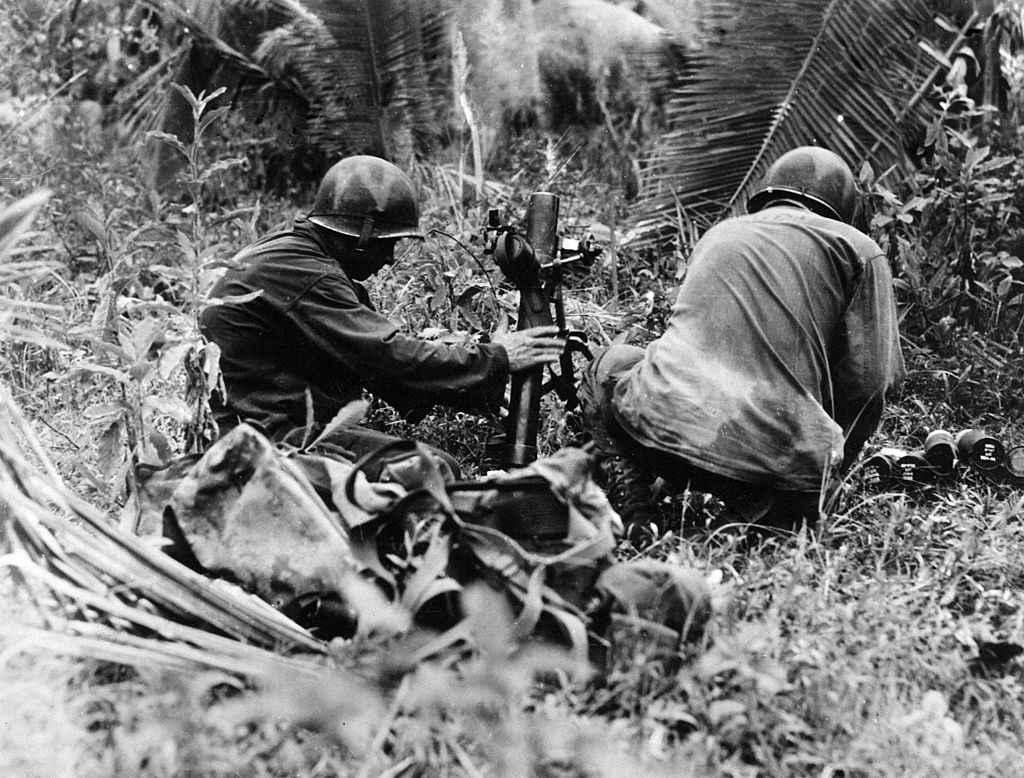 Two American marines firing a 60 mm mortar against the Japanese lines-141556147