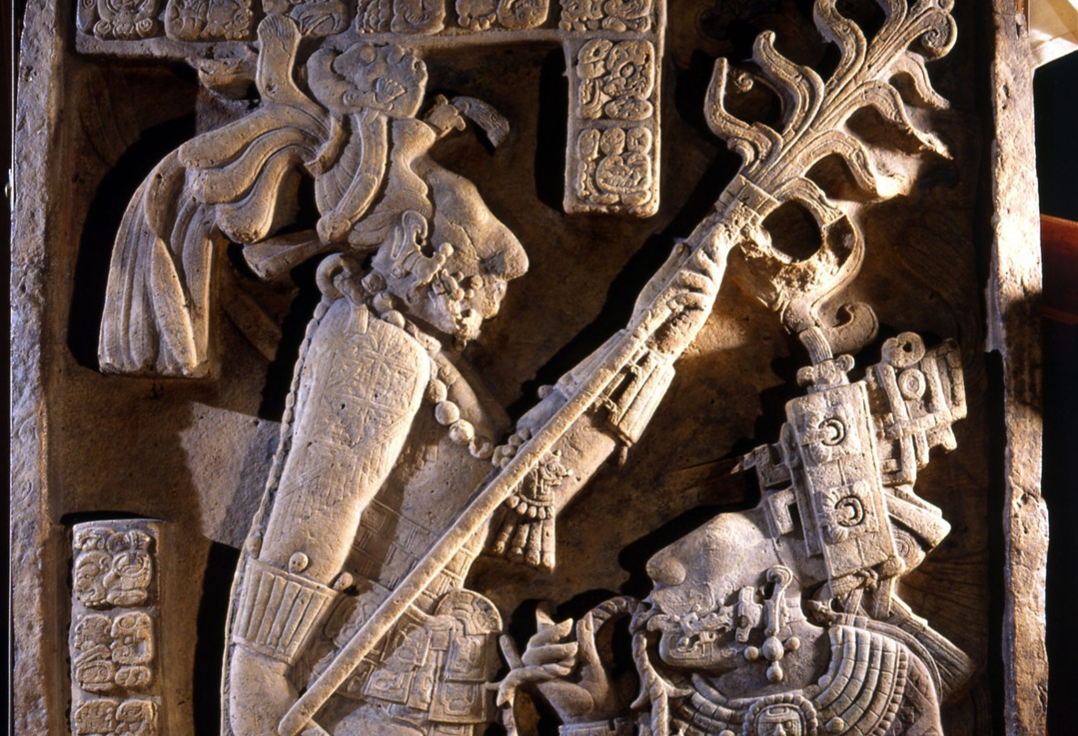 Carving of Lord Shield Jaguar and his wife Lady Xoc is performing a blood sacrifice by drawing a thorn rope through her tongue.