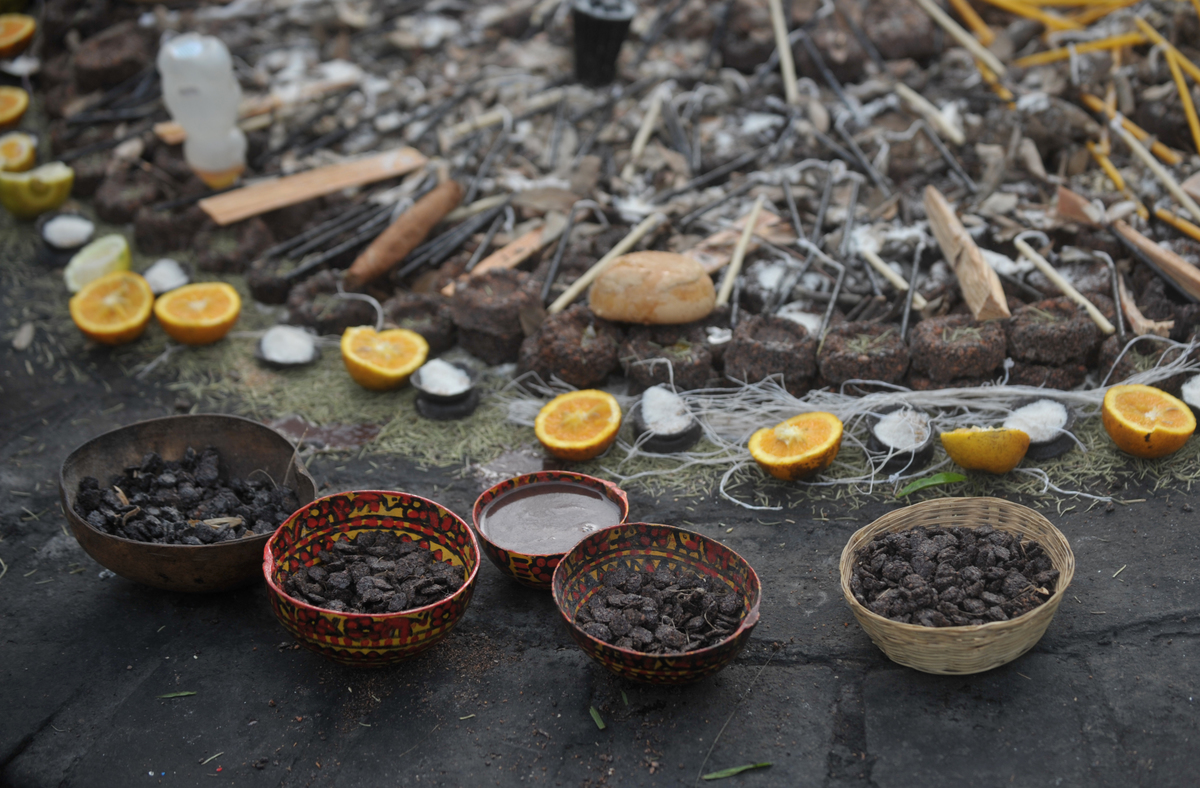 Cacao, candles, cigars, oranges and ocote wood are seen during the celebration of