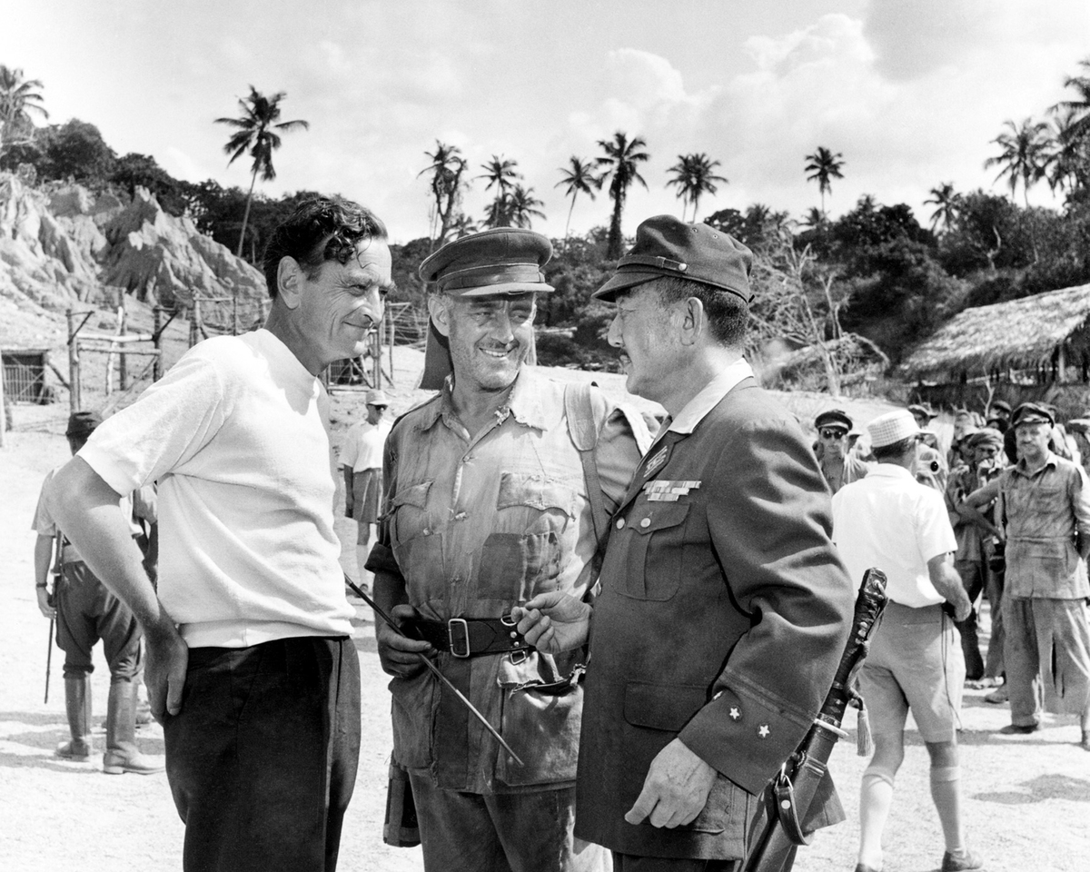 British director David Lean (1908 - 1991, left) with Alec Guinness (1914 - 2000, centre) and Sessue Hayakawa (1889 - 1973) on the set of 'The Bridge On The River Kwai', Sri Lanka, 1952.