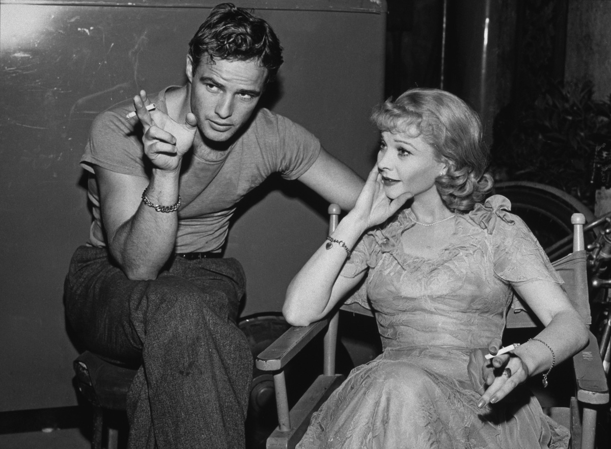 American actor Marlon Brando (1924 - 2004) and British stage and film actress Vivien Leigh (1913 - 1967) relax on the set of 'A Streetcar Named Desire', circa 1951.