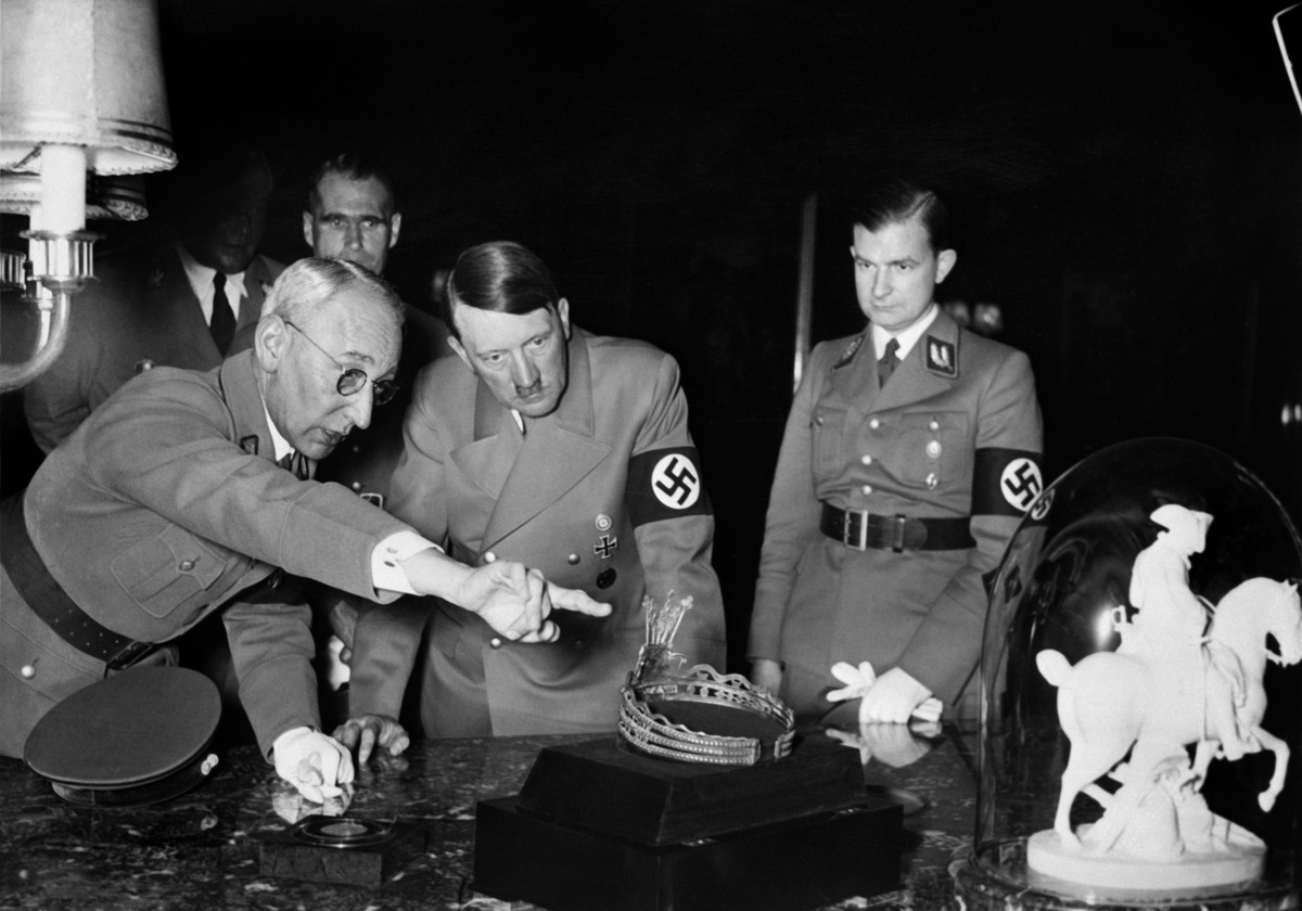 An undated and unlocated picture shows German Nazi chancellor Adolf Hitler looking at a tiara and a sculpture of Napoleon Bonaparte
