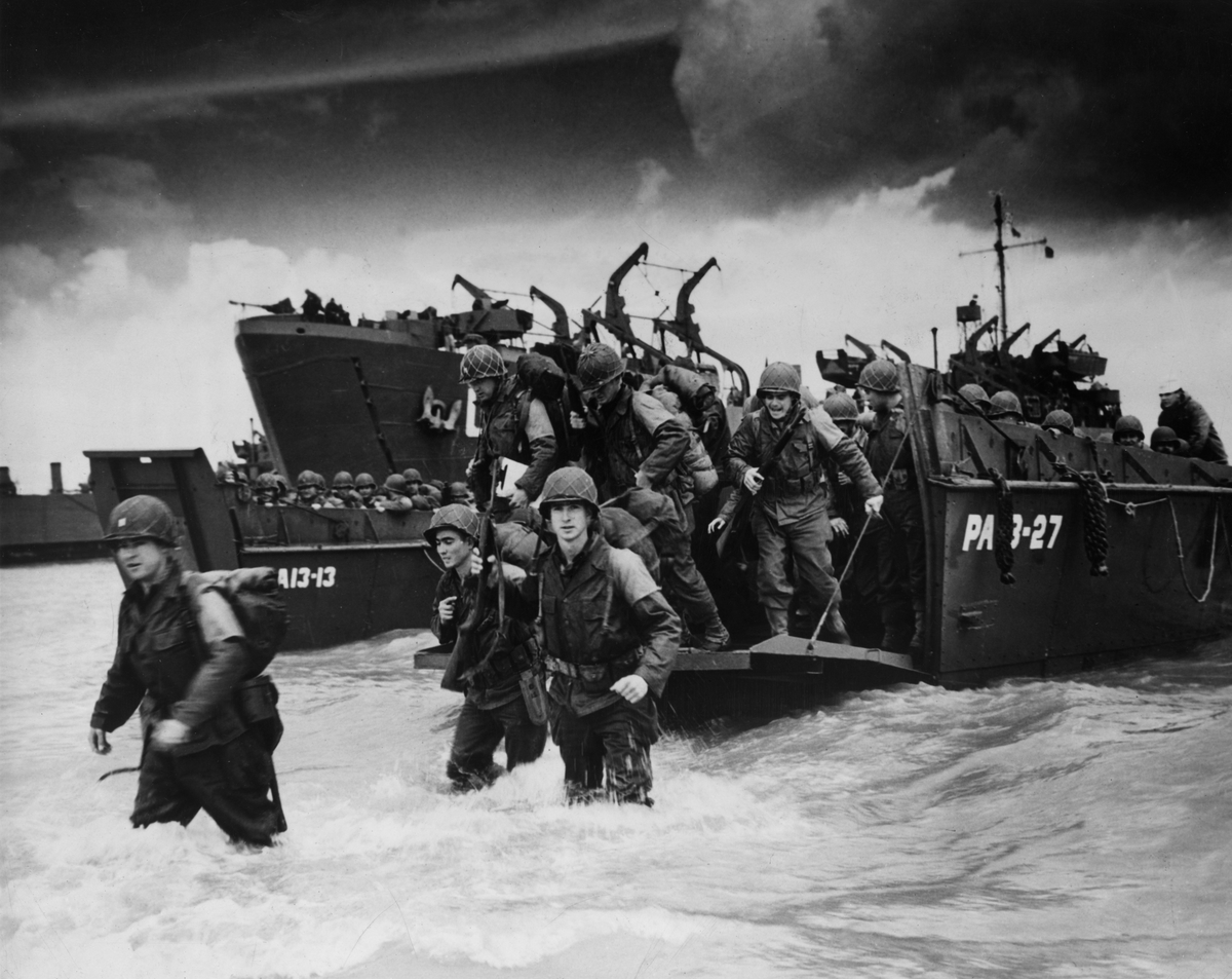 6th June 1944: Reinforcements disembarking from a landing barge at Normandy during the Allied Invasion of France on D-Day.