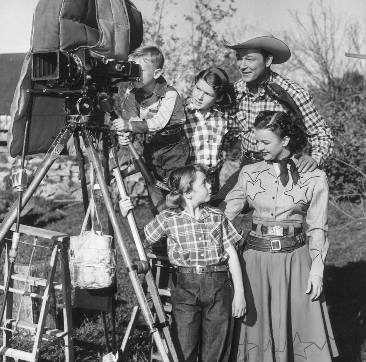 Married American actors and singers Roy Rogers (1911 - 1998) and Dale Evans (1912 - 2001) show their children, (clockwise; L-R) Dusty, Cheryl and Linda Lou, a motion picture camera on the set of one of their made-for-TV films.