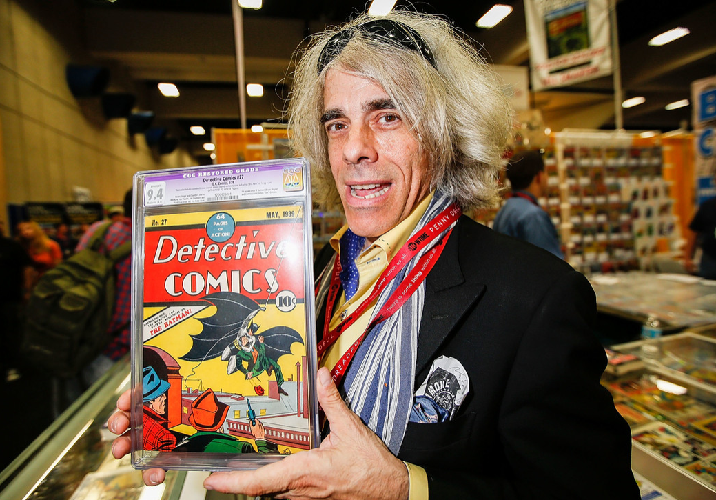 Michael Carbonaro of D&A Cardworld poses with Detective Comics #27 at Comic-Con International at San Diego Convention Center