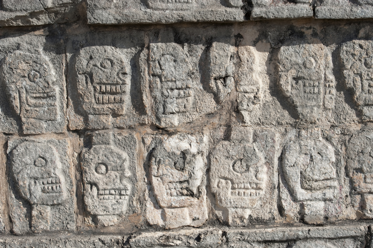 The Tzompantli, or Platform of the Skulls, carved into Mayan ruins in the Yucatan Peninsula, Mexico.