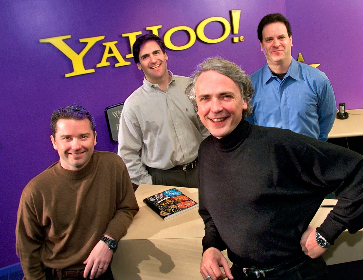 Yahoo! Inc. Executives, Front, Jeff Mallett, President And Coo, And Tim Koogle, Chairman And Ceo, And Broadcast.Com Inc. Executives, Rear, Mark Cuban, President And Chairman, And Todd Wagner Ceo And Vice Chairman