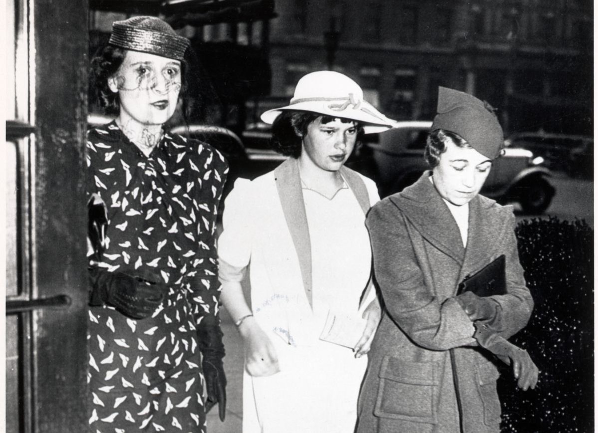 Gloria Vanderbilt is shown with her mother, Mrs. Reginald C. Vanderbilt, right, and a governess, left, as they returned to their hotel, here.