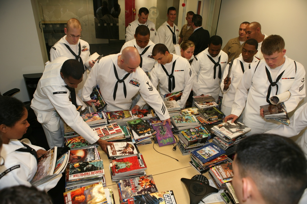 Sailors and Marines look through comic books during a tour of the DC Comics facility