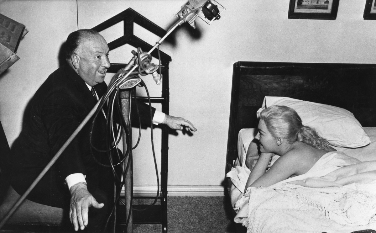 alfred hitchcock directs kim novak on the set of vertigo.