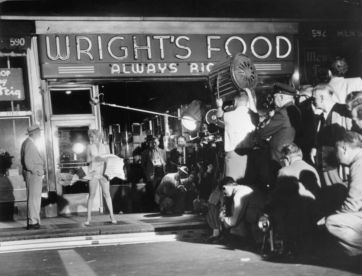 marilyn monroe and tom ewell filming an iconic scene from the seven year itch.